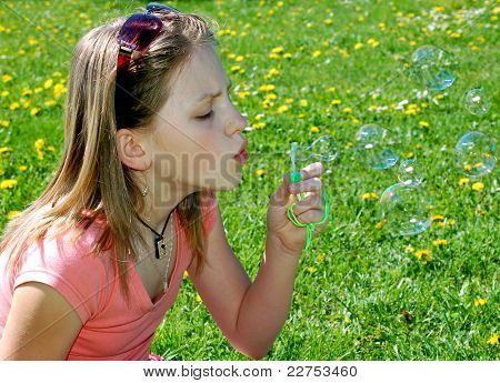 Girl with a bubble blower