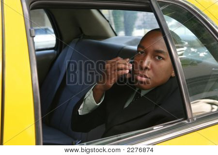 Business Man In Taxi