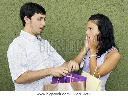 Young Couple Arguing About Shopping