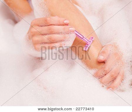 Woman Shaving Legs