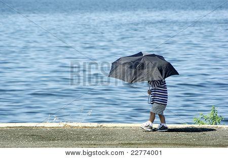 Boy and umbrella