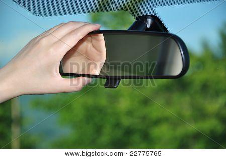 Adjusting rear view mirror