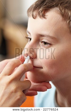 Child Taking A Dose Of Nasal Spray