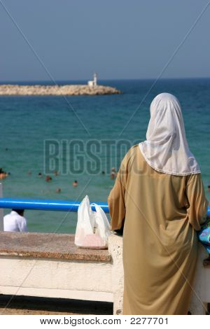Muslim Woman Looking At The Beach