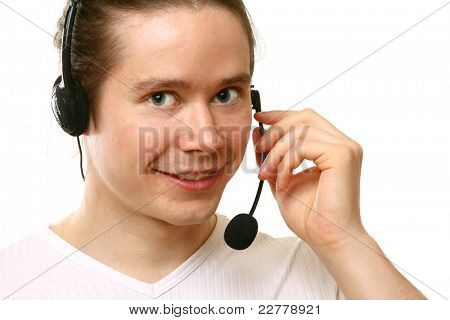 Closeup portrait of happy young man talking on headset, smiling. Isolated on white.