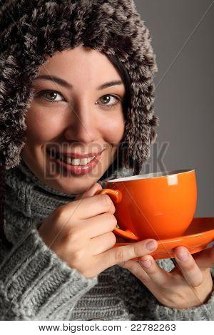 Beautiful Girl In Warm Wool Hat Drinking Tea