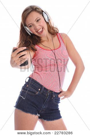 Teenage Girl Singing To Music From Her Cell Phone
