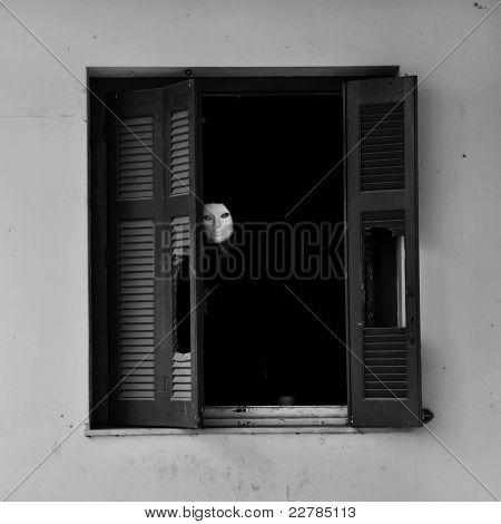 Masked Figure By Broken Window