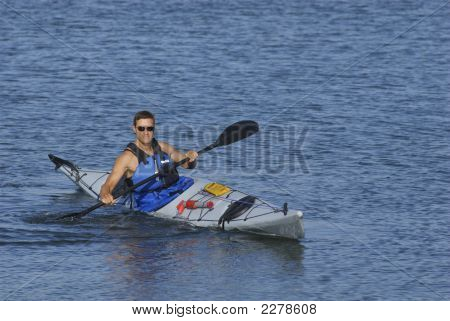 Athletic Man Showing Off His Kayaking Skills