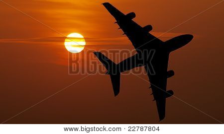 Airliner over red sunset