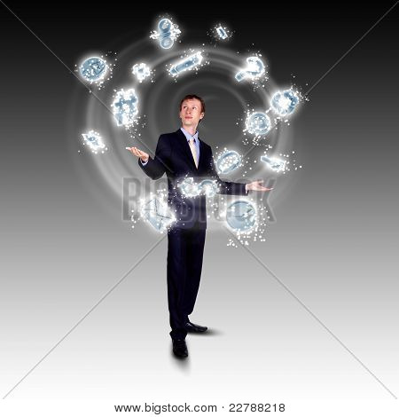 Business man juggling with numbers and symbols