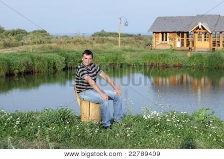 Man Sits On The Lakeside