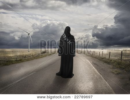 Muslim woman searching for the right way, lost in time and place - concept