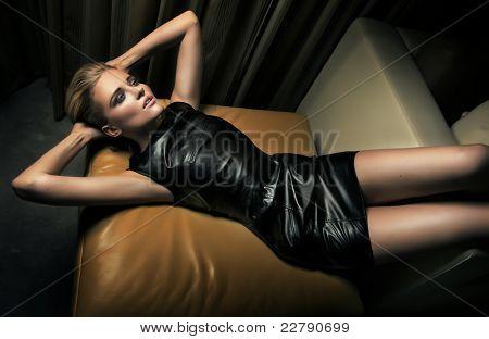 Sexy woman lying on armchair
