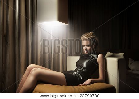 Sexy woman lying on armchair
