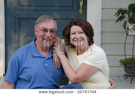 Happy Couple On Their Porch