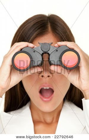 Binoculars woman looking surprised at camera - closeup of business woman in white suit looking.