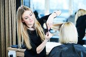 Barber or stylist at work. Hairdresser cutting woman hair poster