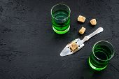 Traditions Of Drinking Absinthe. Special Spoon And Sugar Cubes Near Shots On Black Background Top Vi poster