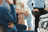 People at group psychotherapy session indoors poster