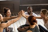Fit Sporty Happy Multicultural People Giving High Five At Yoga Training, Motivated Multiracial Group poster