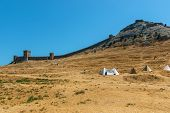 The Ruins Of The Ancient Turkish Fortress In Crimea, Sudak. The Ruins Of The Ancient City. The Fortr poster