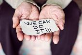 closeup of an old caucasian woman indoors with a piece of paper in her hands with the text we can do poster