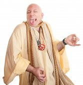stock photo of swami  - Crazy bald guru plays air guitar over white background - JPG