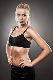 stock photo of athletic woman  - Studio shot of a very fit athletic woman - JPG