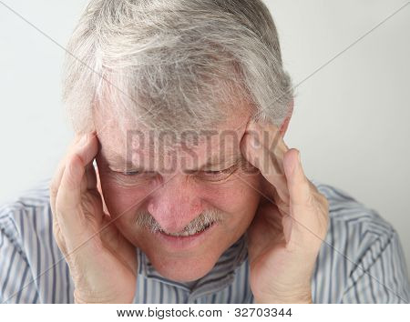 man with terrible headache