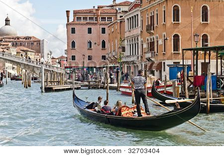 Gondolier On Venice Grand Canal