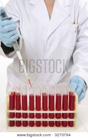 Scientist Using Pipette To Extract Samples