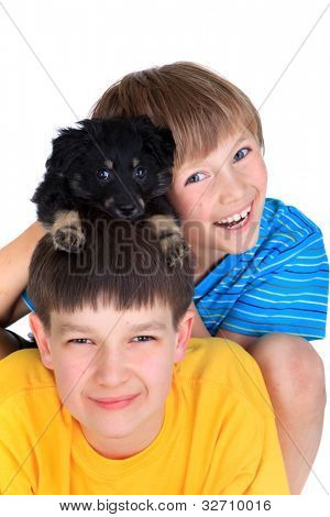 Boys and a small dog.
