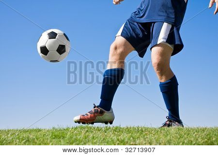 Soccer Player Kicking the ball - low angle