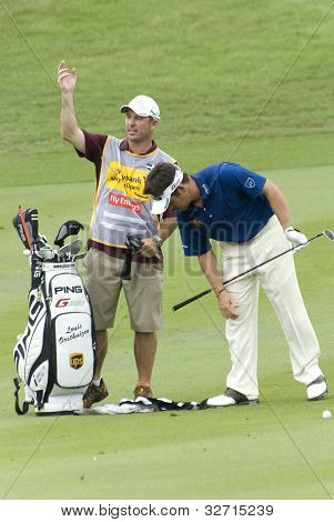 Louis Oosthuizen, South Africa golfer with his caddy