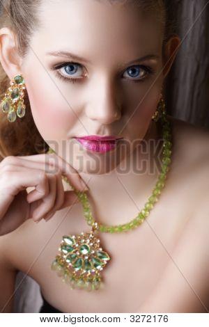 Blond Beautiful Woman In Green