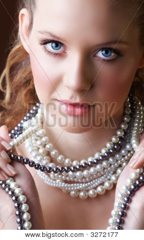 Blond Woman In Pearls