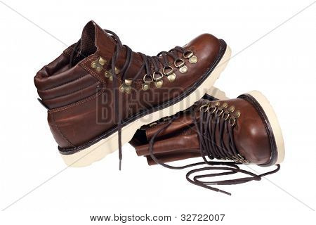 A pair of hiking boots isolated over white with clipping path.