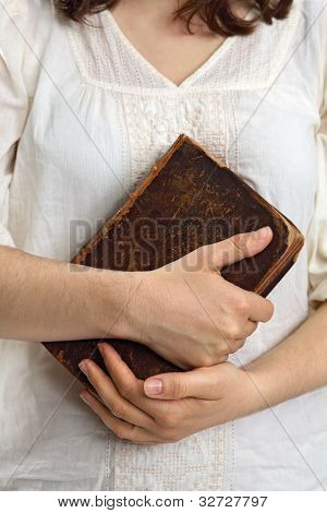Hands Holding Old Bible