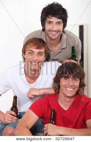 Three lads with bottles of beer