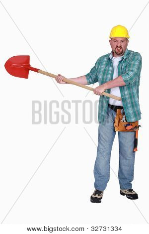 angry craftsman holding a shovel