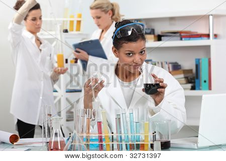 Women conducting science experiment