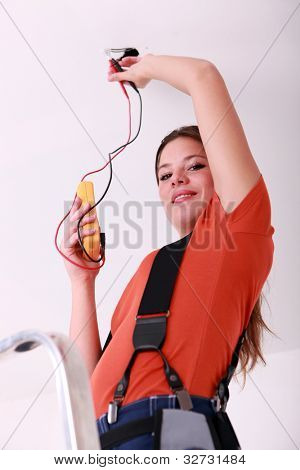 Woman with voltmeter