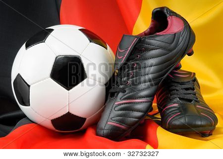 Soccer Ball And Shoes On German Flag