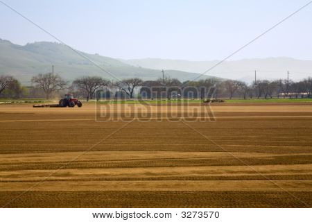 Tractor Plowing Large Field
