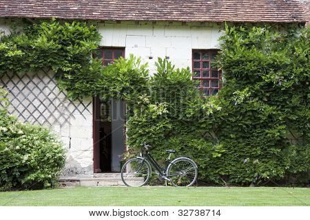 Bike Near The Entrance In A Traditional House, France