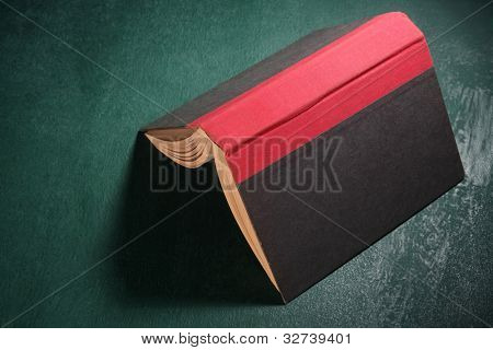 open book on the black board