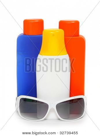 UV protection equipment for happy holidays. Sunglasses and sun lotion.