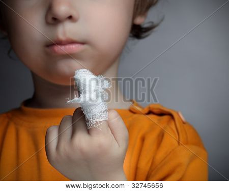 boy with a wound on his finger