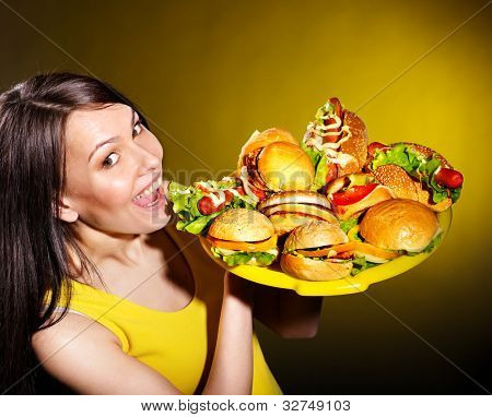 Thin woman holding group hamburger.